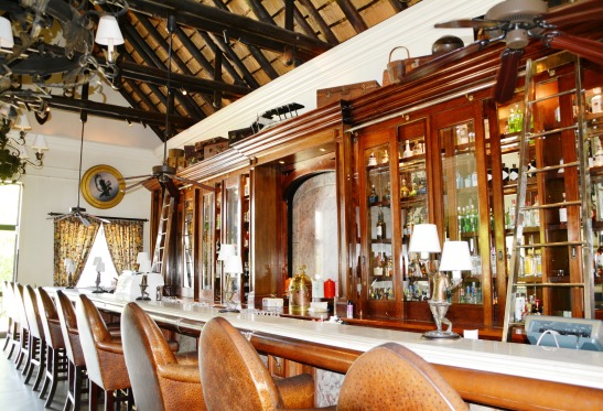 a-colonial-bar-with-suitcases-on-top-of-the-display-cabinets