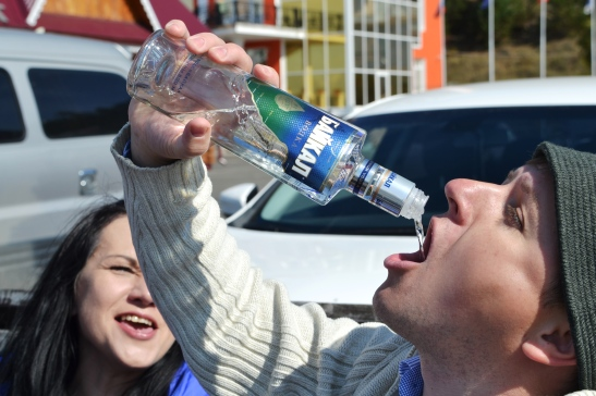 Brave Russian youngsters drinking vodka for breakfast on the pier