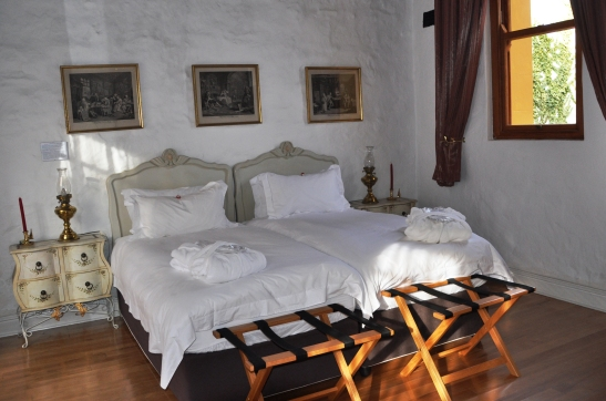 guestrooms-at-the-old-jail-are-furnished-with-antique-furniture-and-quality-bed-linen