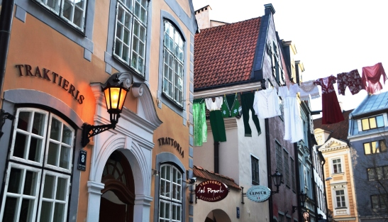 Throughout the Old Town of Riga buildings feature old-style lanterns and many have Gothic spires on their roofs