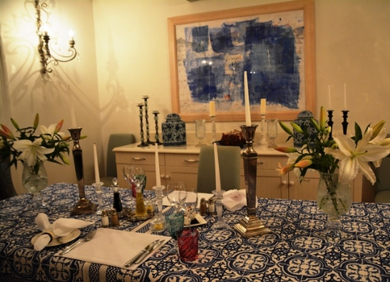 Dinner for two served in the dining room with elegant blue and white accents
