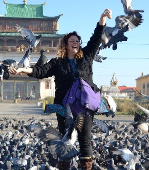 Feeding pigeons in Ulaanbaatar