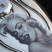 Marilyn Monroe rides a bike