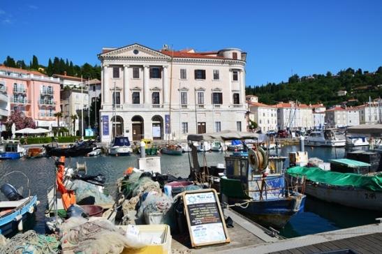 Die vissersbootjies gee jou reeds 'n aanduiding dat jy heerlike seekos in Piran gaan eet