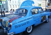 A cluster of advertorial and unusual cars are parked in front of Kazan Cathedral in Nevsky Prospekt, Saint Petersburg