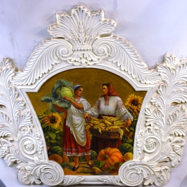 A mural depicting rural life in a Moscow metro station
