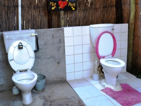 Adjoining his-and-her loos at Ngepi Camp in Caprivi, Namibia