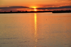Relax and watch the sunset at Ngepi Camp in the Caprivi